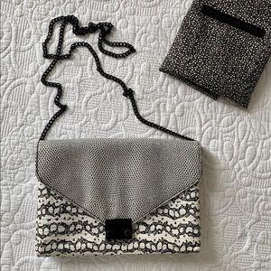 Loeffler Randall leather envelope lock cluch